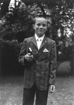 THEN:  John C. Hampsey, seen here as a 7-year-old after his first communion, writes of boyhood events between age 7 and 14. - PHOTO COURTESY OF JOHN C. HAMPSEY