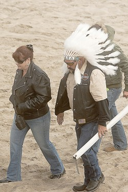 ON THE WAR PATH :  One Indian motorcycle enthusiast donned a chief's headdress. - PHOTO BY STEVE E. MILLER