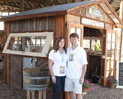 BEAUTIFUL RECYCLING:  A Place to Grow creates custom-made greenhouses out of recycled materials that'll make any yard look fantastic. Pictured here are the owners Dana and Sean O'Brien with a greenhouse showcased at the Sunset Savor the Central Coast event in Santa Margarita. - PHOTO BY STEVE E. MILLER