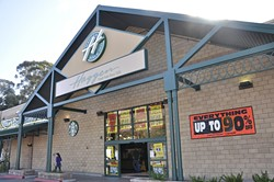 CLOSED FOR THE HOLIDAYS:  The Johnson Avenue Haggen store in San Luis Obispo advertises an up-to-90-percent-off sale before they closed their doors. Six Haggen stores in San Luis Obispo County have closed and gone up for sale, leading to approximately 400 layoffs. - PHOTO BY JONO KINKADE