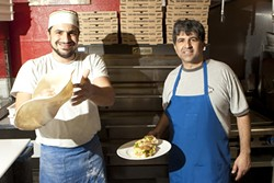 FLYING FOOD :  Roberto Zillante (left) tosses fresh pizza dough and Ciro D'Onofrio (right) showcases one of the many Italian sandwiches available at this new pizzeria. - PHOTO BY STEVE E. MILLER