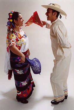 COLOR AND DANCE :  Horacio Heredia and Lela Gabaldon perform a dance from Veracruz, Mexico. - PHOTO BY OCTAVIO BARBA