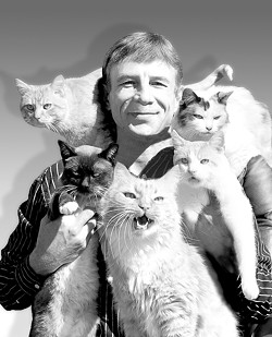 """ONE BIG FLUFFY FAMILY :  Gregory Popovich adopts all of his furry performers from animal shelters and regards them as family. This picture was originally titled """"Popovich and kids."""" - PHOTO COURTESY OF COMEDY PET THEATER"""