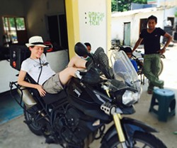 LAID BACK:  Heather Johnson (left) rests on her Triumph Tiger in La Venta, Tabasco, Mexico after it broke down when she hit a pothole. - IMAGE COURTESY OF HEATHER JOHNSON