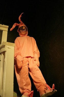 THE HORRIBLE GIFT!:  Ralphie (Christopher Jensen) bear his shame as he has to model the dreaded bunny PJs outfit. - PHOTO BY GLEN STARKEY