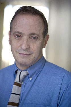 NOTHING CAN NOT BE IN YOUR LAP :  David Sedaris talks bedbugs and unicorn-shaped uteri with New Times. - PHOTO BY ANNE FISHBEIN