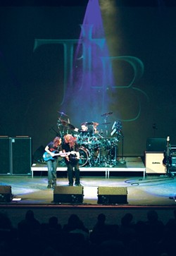 WE WHO ARE ABOUT TO ROCK, SALUTE YOU :  Prog-rock heroes The Travis Larson Band will promote their new live CD and DVD Rate of Change with a May 30 in-store at Boo Boo Records and a June 4 concert at Frog and Peach. - PHOTO COURTESY OF TRAVIS LARSON BAND