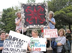 PRO PATRIA :  Susan Krueger's quilt serves as a banner in an anti-war protest. - IMAGE COURTESY OF SUSAN KRUEGER