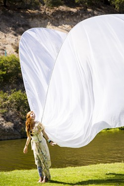 TAKE WING:  This angel's costume wasn't the most elaborate, but it was the tallest! - PHOTO BY HENRY BRUINGTON