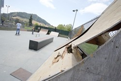 THRASHED SLO :  parks officials purchased $50,000 worth of temporary ramps for the city's skate park. But with the original equipment literally disintegrating and a new concrete park still years away and hundreds of thousands of dollars short from completion, the new equipment is just a Band-Aid until a permanent park is built. - FILE PHOTO BY STEVE E. MILLER