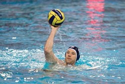 NICE HAT! :  SLO Olympian Jeff Powers fields a ball during a water polo match. - PHOTO BY JEFF SHEWMON