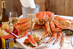 WEAR A BIB:  King crab won't easily surrender but is well worth the battle, at Cracked Crab in Pismo Beach. - PHOTO BY STEVE E. MILLER