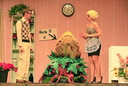 HERE IT IS! :  Timid florist Seymour (Ryan Cordero) hopes his botanical discovery will win him the affections of his coworker Audrey (Jennifer Malman) in Little Shop of Horrors. - PHOTO BY SANDRA CORTEZ