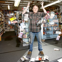 THAT'S ALL, FOLKS :  Bob Whiteford, the owner, must close the venerable Insomniac Video because movies are no longer flying from his shelves. - PHOTO BY STEVE E. MILLER