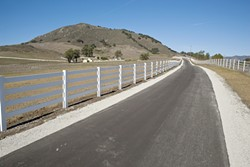 HAPPY TRAIL:  The Madonna Inn bicycle path, set to open to the public in winter 2011, will run along the Madonna Inn property and connect downtown San Luis Obispo to the Madonna Road shopping center and Laguna Middle School. - PHOTO BY STEVE E. MILLER