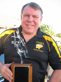 """PROUD HOOPS COACH :  Warren Hooper of Hooper Studios recently sculpted the trophy at the center of San Luis Obispo and Mission College Prep high schools' basketball rivalry. SLO High assistant basketball coach Kirby Gordon (pictured with the trophy) called it """"exquisite."""" - PHOTO COURTESY OF KIRBY GORDON"""