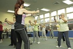 THIN LIZZIE :  San Luis Coastal Unified School District offers strength training, body conditioning, aerobic, and flexibility classes at 1500 Lizzie St. in SLO, such as this one led by Michele Vanderlinde. - PHOTO BY STEVE E. MILLER