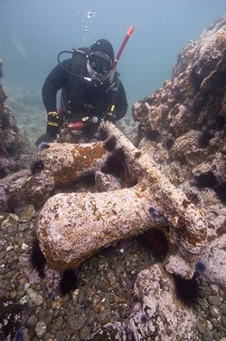 SUNKEN TREASURE :  Diver Patrick Smith behind a massive mooring bit. The sheer size let the team know they were looking in the right place. - PHOTO COURTESY OF ROBERT SCHWEMMER