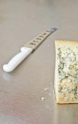 BLOCK HEAD:  Blue Stilton is one of many artisan cheeses the Santa Ynez shop is selling. - PHOTO BY CAMILLIA LANHAM