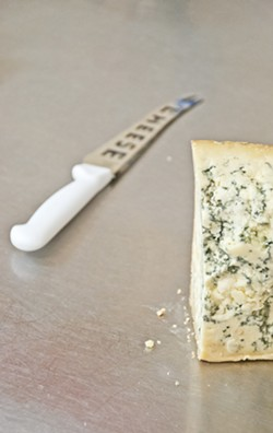 BLOCK HEAD:  Blue Stilton is one of many artisan cheeses the Santa Ynez shop is selling. - PHOTO BY CAMILLIA LANHAM