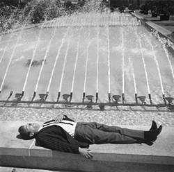DAY DREAMER :  Tress captured this dozing businessman in San Francisco's Union Square. - PHOTO BY ARTHUR TRESS