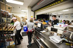 LUNCHTIME!:  As Laguna's roughly 700 students spilled into the cafeteria for lunch, the unflappable food service workers behind the counter kicked into high gear. - PHOTO BY HENRY BRUINGTON