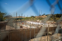 GROWTH IN A TIME OF DECLINE:  Despite fewer youth criminals in the county, SLO's juvenile hall is expanding. The new facility will offer treatment for mental health and drug problems. - PHOTO BY KAORI FUNAHASHI