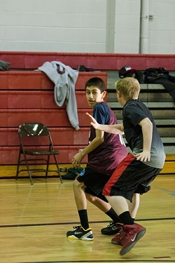 FULL PRESS :  Eighth grader Arturo Resendez faces a defender during an early morning scrimmage over winter break.
