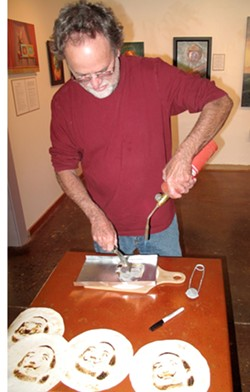 YUMMY, SURREALISM :  Mark Bryan cooks up some Salvador Dali tortillas at the Steynberg Gallery. - PHOTO BY PETER STEYNBERG