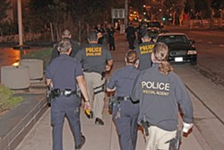 "UNDER COVER OF NIGHT :  U.S. Immigration and Customs Enforcement agents, working with local police officers, conducted an early morning gang ""sweep"" in Los Angeles. ICE has performed several similar sweeps on the Central Coast since 2006, focused primarily in Santa Maria, under a nationwide program called Operation Community Shield. - PHOTO COURTESY OF U.S. IMMIGRATION AND CUSTOMS ENFORCEMENT"