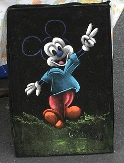 WINNER OF THE KITSCH AWARD! :  A painting of Mickey Mouse? Giving the peace sign? On black velvet? Oh yeah, baby! - PHOTO BY GLEN STARKEY
