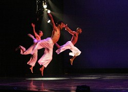 TRIO IN FLIGHT :  A rare sight; the county has a dearth of male dancers. - PHOTO BY KEITH MOSHER