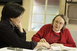 HELPING HAND :  Thai native and ESL student Usa Koonvirarak (left) gets one-on-one tutoring from Marty Nelson. - PHOTO BY STEVE E. MILLER