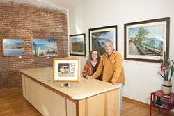 HOME AGAIN :  John Ramos—pictured here in his new gallery with his wife, Donna—returned to the area after living for four years in Mexico. - PHOTO BY STEVE E. MILLER