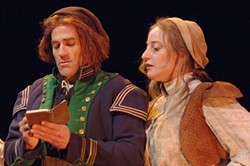 COOKING UP THE BOOKS :  Andrew Philpot and Elizabeth Stuart provide welcome laughter and color as Thenardier and Madame Thenardier. - PHOTO BY LUIS ESCOBAR/ REFLECTIONS PHOTOGRAPHY STUDIO