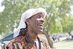 "EARTH DAY SMILES :  Everyone had a great time, including local musician Al ""Shival"" Redwine, at Earth Day. - PHOTO BY GLEN STARKEY"