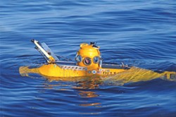 A YELLOW SUBMARINE :  The Delta submarine researchers used to visit the wreck is so small, the operator's chair straddles the passenger, who must lie prone and peer out of a separate porthole. - PHOTO BY ROBERT SCHWEMMER, NOAA