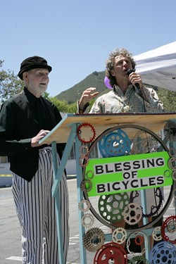 """HOLY ROLLERS!:  Robert Norton (left) took care of the bike blessing, and Mark """"Gizmo"""" Grayson acted as Master of Ceremonies at the inaugural SLO Blessing of the Bicycles on May 18 at Salon 544, at 544 Higuera St. - PHOTO BY GLEN STARKEY"""
