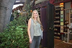 THE ALCHEMIST:  The Secret Garden Owner Kirstin Sherritt sells remarkable all-natural teas, herbs, and spices out of her open-air shop near SLO Creek. - PHOTO BY HAYLEY THOMAS