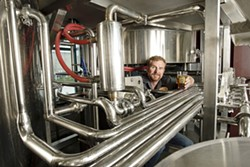 THEY ARE FOUR :  Brewmaster and co-owner John Gordon is part of a four-man team brewing ale in an industrial part of San Luis Obispo. - PHOTO BY STEVE E. MILLER