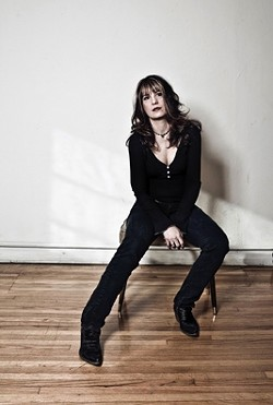 """GUITAR GODDESS :  Steve Key's Songwriters at Play singer-songwriters' showcase continues on July 13 with a feature artist whom Michelle Shocked once called """"one of the best guitarists in the world, male or female."""" That performer is Janet Robin. - PHOTO COURTESY OF JANET ROBIN"""