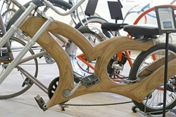SWEET CUSTOM! :  This bike frame crafted from wood is one of several one-of-a-kind bicycles on display. - PHOTOS BY GLEN STARKEY