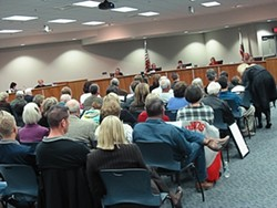 HOT TICKET:   A crowd watches as the Atascadero City Council, acting as a redevelopment agency, pledges $1.5 million for a downtown theater project. - PHOTO BY COLIN RIGLEY