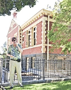 BRICK HOUSE:  Joe tells us about the history of the Carnegie Library, which was built in 1905 and now houses the History Center of SLO County. - PHOTO BY JESSICA PENA