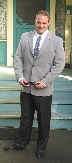GRADUATION :  Joshua Houlgate graduated from Cal Poly in 1995 with a bachelor's degree in sociobiology and minor in psychology. This picture was taken just before his graduation ceremony. - PHOTO COURTESY OF HOULGATE FAMILY