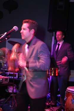 CHA CHA CHA :  De La Bahia members Karl Welz and Mike Raynor keep the rhythm going. - PHOTO BY GLEN STARKEY