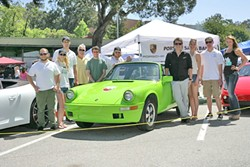 MEET THE CLUB :  (Left to right) Max Kassan, Megan Edwards, Sam Cates, Walt Branscone of Santa Barbara Porsche, alumni Alex Pruitt, Brendan Gill, Ben Roget, Allison Weiner, Kelvin Dedrick, and Dayton Erickson gathered around the Cal Poly Motorcar Association's electric Porsche project. - PHOTOS BY GLEN STARKEY