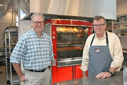 FAMILY STYLE:  From left, SLO Provisions co-owners Steve Bland and Dwyne Willis discovered the joys of rotisserie meats during their travels to France. - PHOTO BY HAYLEY THOMAS