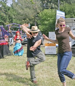 NINJA DANCER :  Local artist and filmmaker Timo Beckwith boogied down with an unidentified female companion. - PHOTO BY GLEN STARKEY
