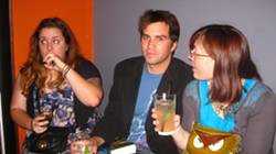 WORK PARTY :  Maeva Considine, Colin Rigley, and Ashley Schwellenbach look in various directions while drinking fancy cocktails for a very public going away party that absolutely anyone could have attended.